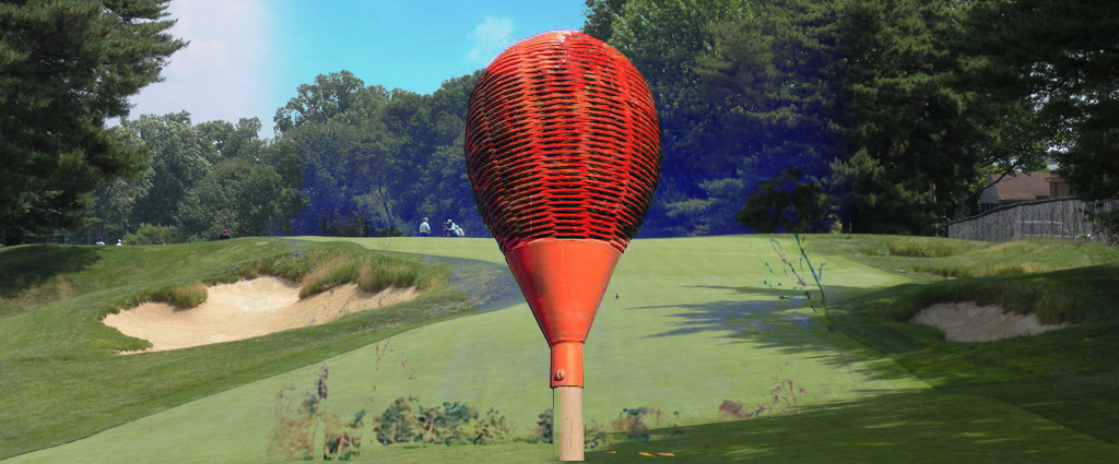 Why are there wicker baskets on the flagsticks at Merion?
