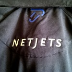 IJP and NetJets logo on the back.
