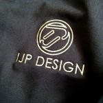 IJP Design logo on the right chest.