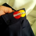 MasterCard logo on the left side collar.