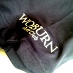 Woburn Golf Club logo on the right sleeve.